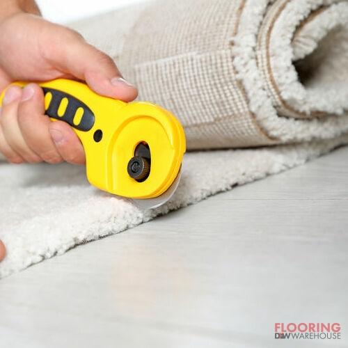 A Technician Cuts Carpet