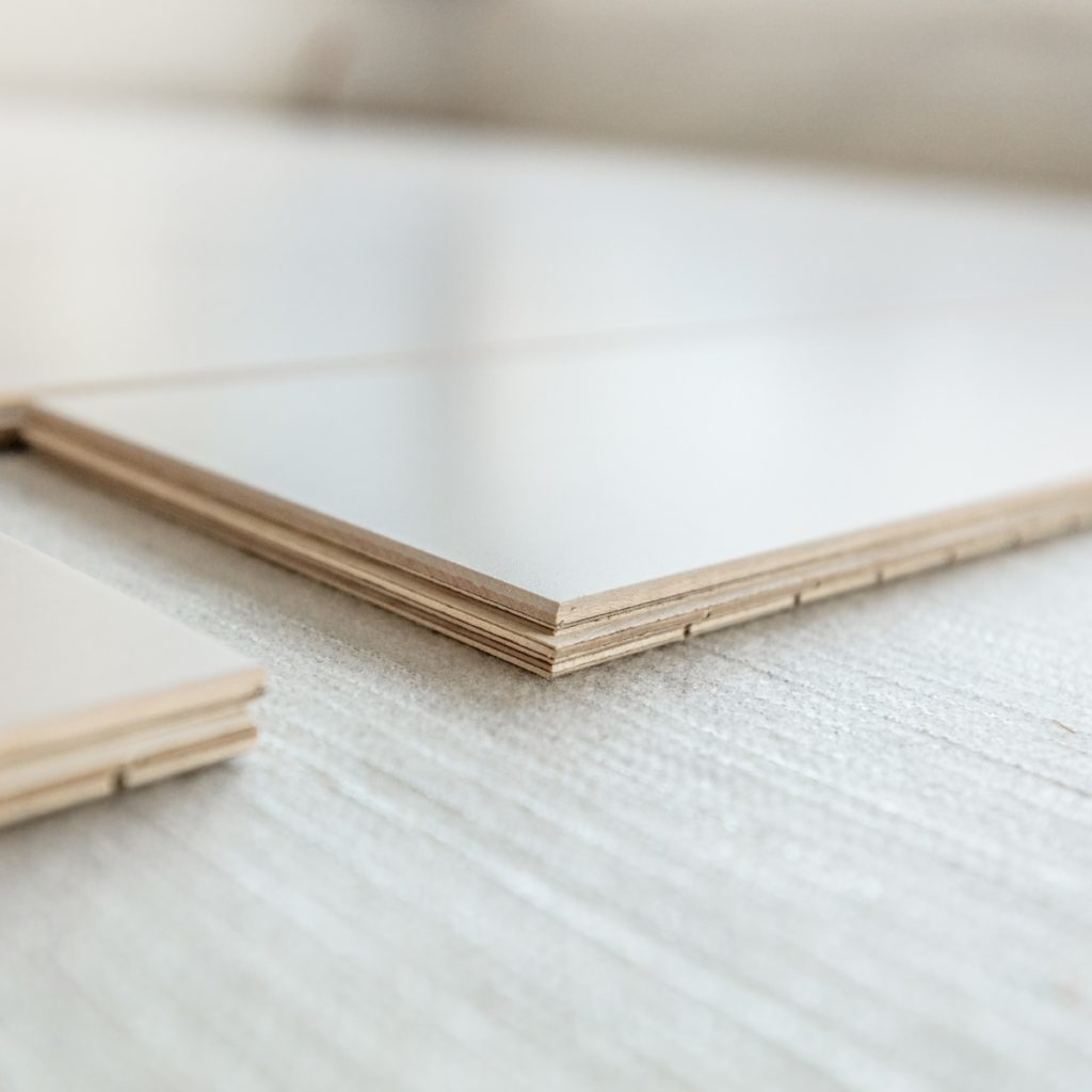 snapboard hardwood flooring being installed