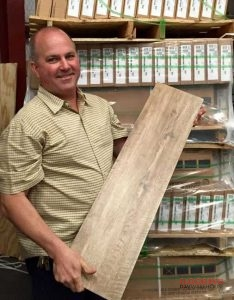 DFW Flooring Warehouse owner holding wood-look tile